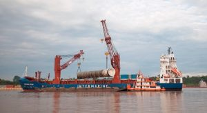 Deethanizer Tower discharging from ship to barge in the Amazon River