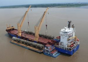 Deethanizer Towers discharging from ship to barge in the Amazon River