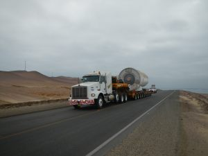 Wind turbine in route to destination with escort