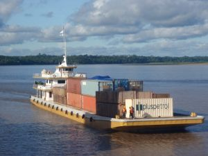 Containers loaded on barge in the Amazon River