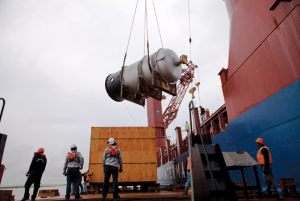 Cryogenic Plant Vessel discharging from ship to barge in the Amazon River