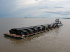 Pipe loaded on barge in the Amazon River