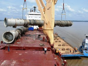 Deethanizer towers discharging onto a barge in the Amazon River
